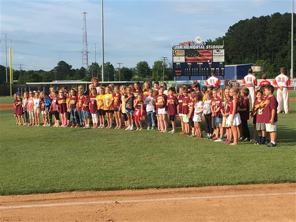 First Graders Sang National Anthem at Pilots Game