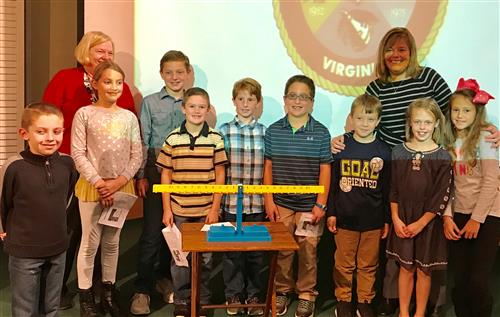 PES Presents Multiplicaiton Manipulatives to School Board